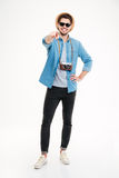 Smiling male photographer with old vintage camera pointing on you Royalty Free Stock Photo
