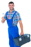 Smiling male repairman with toolbox and spanner Stock Image