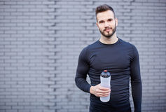 Smiling male runner in shirt Stock Photos