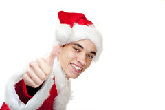 Smiling male santa claus teenager shows thumb up Stock Images