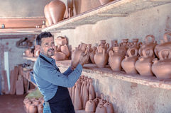 Smiling male sculptor in pottery atelier Royalty Free Stock Photos