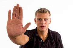 Smiling male showing his stopping gesture Royalty Free Stock Photo