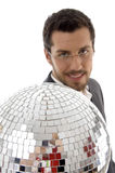 Smiling male showing mirror ball. Against white background Royalty Free Stock Image