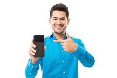 Smiling Male Showing Off His New Mobile Phone. Portrait of smiling male showing off his new mobile phone against white background royalty free stock photos