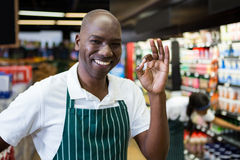 Smiling male staff standing in supermarket Stock Photography