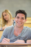 Smiling male student during class. At the lecture hall Stock Images