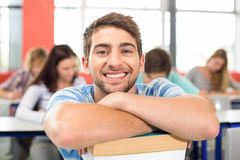 Smiling male student in classroom. Close up portrait of smiling male student in classroom Royalty Free Stock Photography