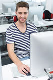 Smiling male student in computer class. Portrait of smiling male student in computer class Royalty Free Stock Image