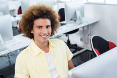 Smiling male student in computer class. Portrait of smiling male student in computer class Royalty Free Stock Photo