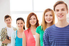 Smiling male student with group of classmates. Friendship and education concept - smiling male student in front of group of classmates Royalty Free Stock Photography