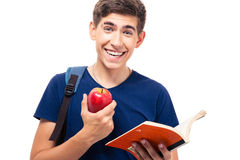Smiling male student holding apple and book Royalty Free Stock Photos