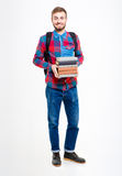 Smiling male student holding books. Full length portrait of a smiling male student holding books standing isolated on a white background Stock Images