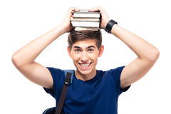 Smiling male student holding books on head. Isolated on a white background. Looking at camera Stock Images