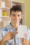 Smiling male Student with notebook. Smiling male Student with blank notebook Stock Photography