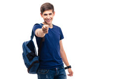 Smiling male student pointing at camera Stock Photos