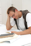 Smiling male student reading Stock Photos
