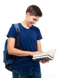 Smiling male student reading book. Isolated on a white background Stock Image