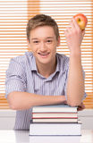 Smiling male student with stack of books. Royalty Free Stock Photo