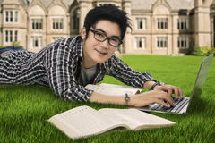 Smiling male student studying. Portrait of male high school student studying on the park Royalty Free Stock Photos
