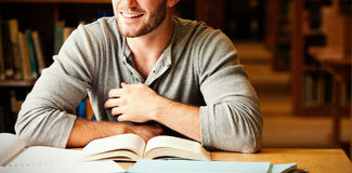 Smiling male student working. In a library Stock Photos