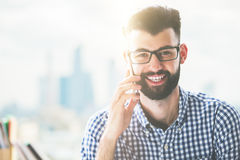 Smiling male talking on phone. Portrait of smiling caucasian male talking on mobile phone Royalty Free Stock Images