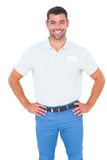Smiling male technician standing hands on hip Stock Photography
