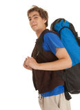 Smiling male tourist with backpack. White background Stock Image