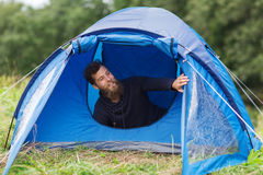 Smiling male tourist with beard in tent Stock Photography
