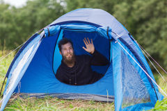 Smiling male tourist with beard in tent Stock Image