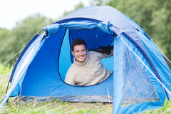 Smiling male tourist in tent Royalty Free Stock Photo