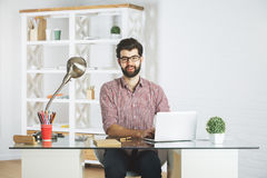 Smiling male using laptop Stock Photography