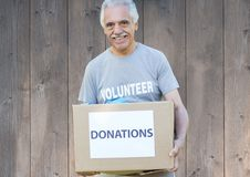 Smiling male volunteer holding donations box Stock Image