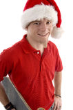 Smiling male wearing christmas hat. Against white background Royalty Free Stock Image