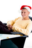 Smiling male wearing christmas hat. In an office Royalty Free Stock Photo