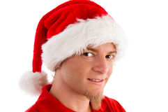 Smiling male wearing christmas hat. On an isolated white background Royalty Free Stock Images