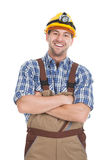 Smiling Male Worker Standing Arms Crossed Over White Background Royalty Free Stock Images