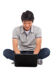 A smiling male working on a laptop Stock Photography