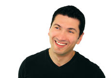 Smiling Man. A portrait of a smiling man in his thirties wearing black t-shirt over white background Stock Photos