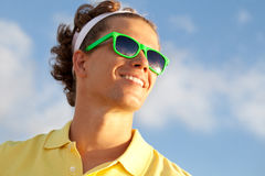 Smiling man. Smiling adorable man by the sun Stock Images