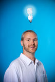 Smiling Man. Happy man with a beard with a light bulb royalty free stock photo