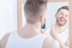 Smiling man admiring his reflection Royalty Free Stock Images