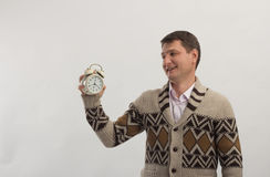 Smiling man with alarm clock in hand Royalty Free Stock Photo