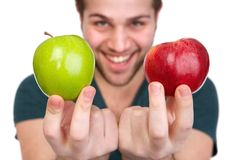 Smiling man with apples Royalty Free Stock Image