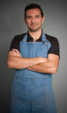 Smiling man with apron Stock Photos