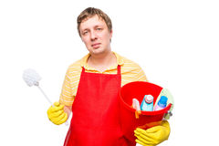 Smiling man in an apron holding a bucket with cleaning agents Royalty Free Stock Photography