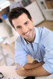 Smiling man with arms crossed Stock Image