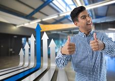 smiling man with arrows and thumbs up stock photography