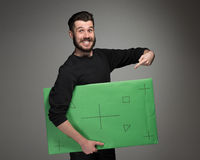 The smiling man as businessman with green panel Stock Photo