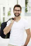 Smiling man with bag. And spectacles Royalty Free Stock Photo