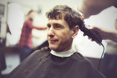 Smiling man in a barbershop Stock Photography